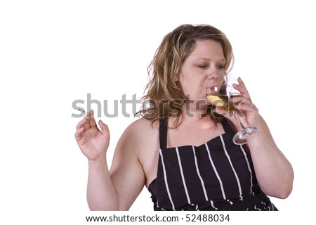 Beautiful Woman Drinking Wine and Smoking in the Kitchen