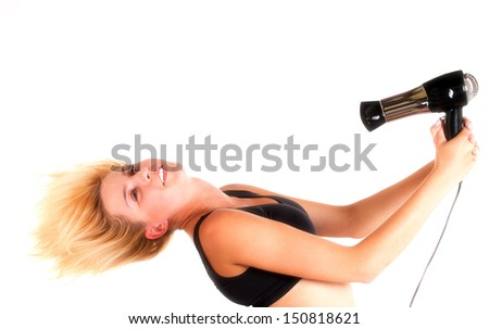 Beautiful woman drying her hair with hairdryer isolated on white