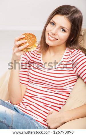 Beautiful woman eating a hamburger