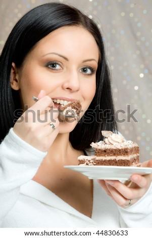 Beautiful woman eating chocolate cake