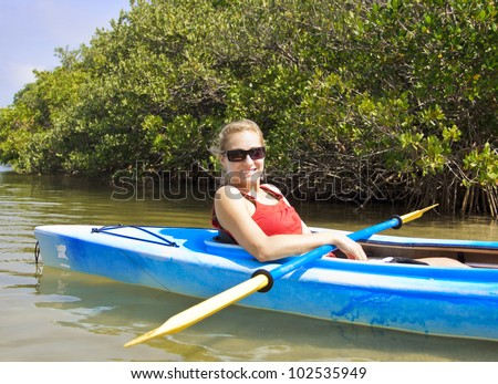 Beautiful woman enjoying a kayak ride