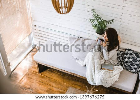 Beautiful woman enjoying cup of tea in her cosy house #1397676275