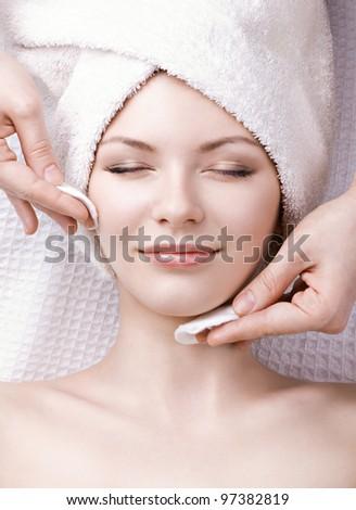 beautiful woman enjoying facial massage