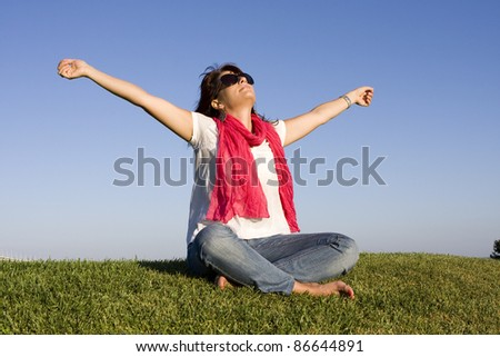 Beautiful woman enjoying life with her arms outstretched