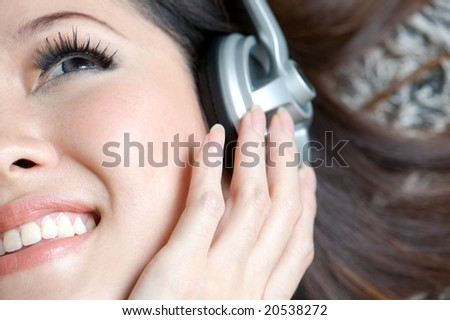 beautiful woman enjoying music close up