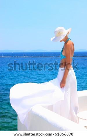 Beautiful woman enjoying the beach in Greece - Shutterstock ID 61866898