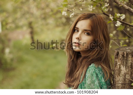 beautiful woman enjoying the freshness of a lone