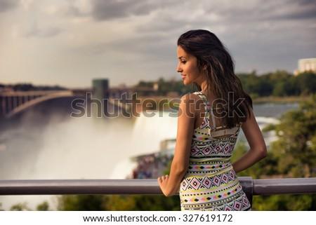 Beautiful woman enjoying the view of Niagara Fall