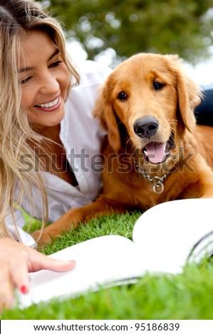 Beautiful woman enjoying with her dog outdoors
