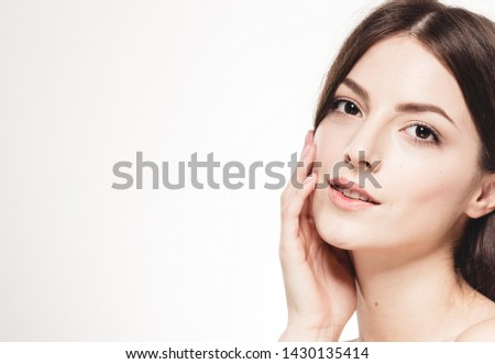 Beautiful woman face close up healthy skin