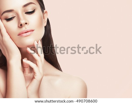 Beautiful woman face close up studio on pink  - Shutterstock ID 490708600
