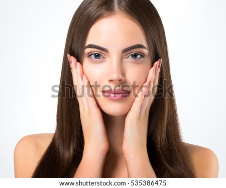 Beautiful woman face closeup portrait hands on skin #535386475