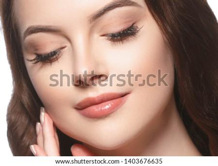 Beautiful woman face closeup with beauty makeup and brunette hair closeup #1403676635
