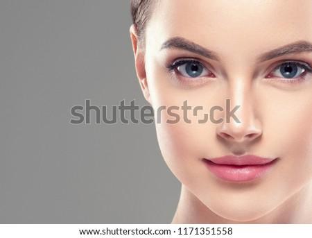 Beautiful woman face lips nose closeup beauty skin care concept #1171351558