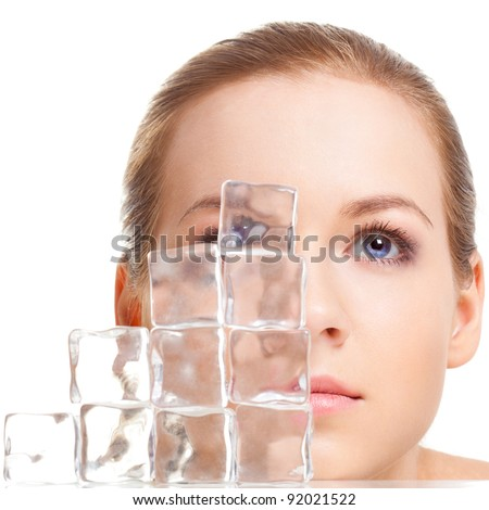 beautiful woman face near ice cubes over white background