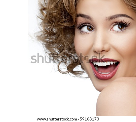 Beautiful woman face. Perfect toothy smile. Caucasian young girl close up portrait. red lips,  skin, teeth.  Isolated on white background. Studio shot . happy positive girl.