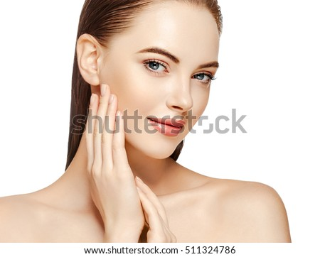 Beautiful Woman Face Portrait Beauty Skin Care Concept Beautiful beauty young female model girl touching her face skin cheeks hands fingers. Fashion Beauty Model isolated on white