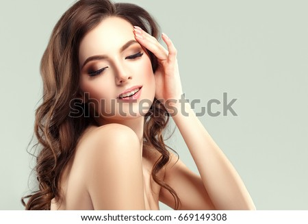 Beautiful Woman Face Portrait Beauty Skin Care Concept. Fashion Beauty Model with beautiful hair and beautiful hands manicure nails