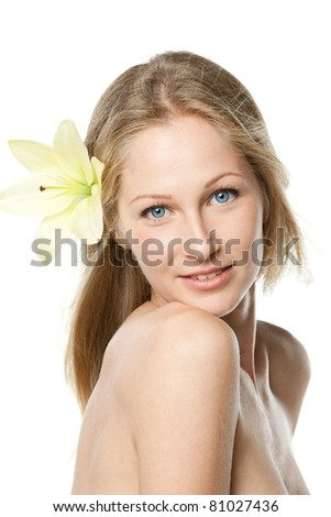 Beautiful woman face with a flower, isolated on white background