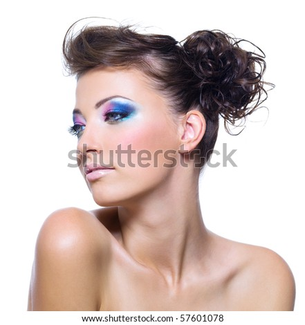 Beautiful woman face with bright make-up and creative hairstyle
