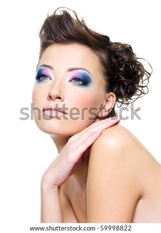 Beautiful woman face with bright makeup and creative hairstyle