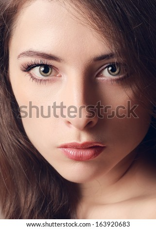 Beautiful woman face with green eyes. Vintage closeup portrait