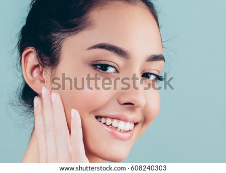 Beautiful Woman Face with hands Portrait Beauty Skin Care Concept. Fashion Beauty Model isolated on gray background #608240303
