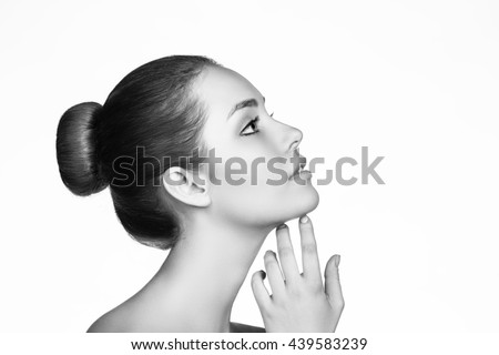 Beautiful woman face with perfect skin - Shutterstock ID 439583239