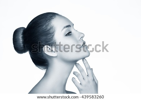 Beautiful woman face with perfect skin - Shutterstock ID 439583260
