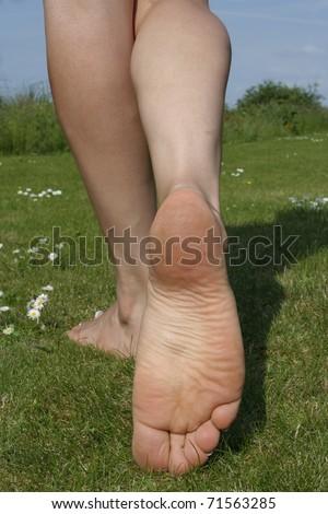 Beautiful Woman  feet  enjoying a sunny day outdoors