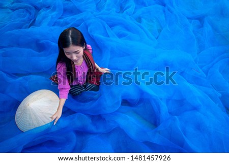 Beautiful woman fisherman is cleaning The fishing nets. #1481457926