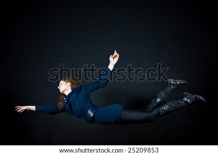 beautiful woman flying in studio