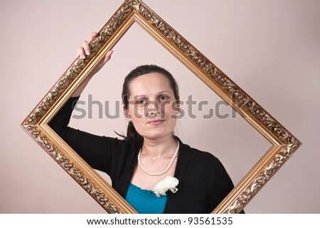 beautiful woman framed in a antique frame - stock photo
