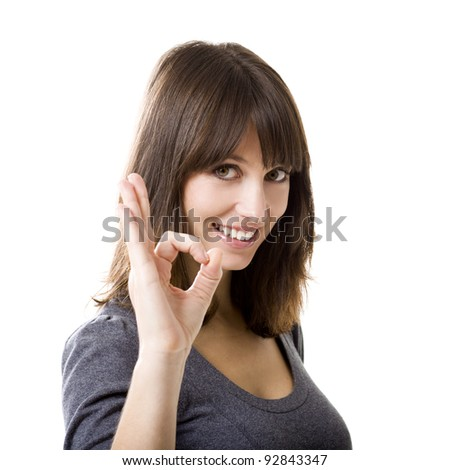 Beautiful woman gesturing an excellent job sign isolated over white background