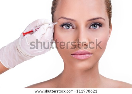 Beautiful woman gets botox injection in her face, correction upper lids