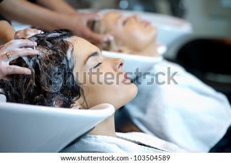 Beautiful woman getting a hair wash. In a hair salon