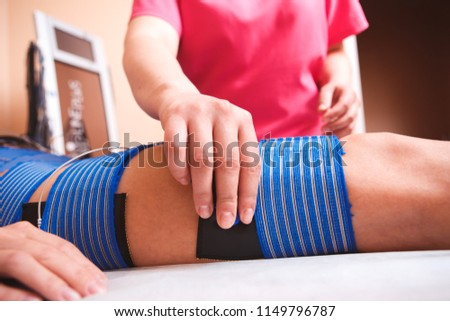 Beautiful woman getting electro stimulation therapy #1149796787