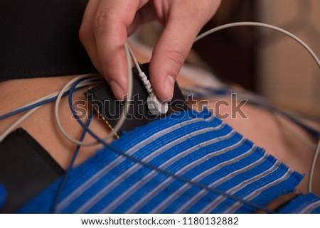 Beautiful woman getting electro stimulation therapy #1180132882