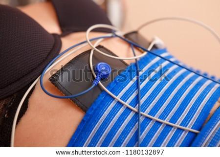 Beautiful woman getting electro stimulation therapy #1180132897