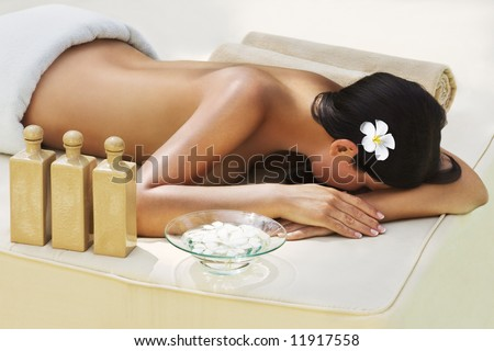 Beautiful woman getting spa treatment at daylight outdoor - stock photo