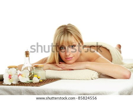 Beautiful woman getting spa treatment isolated