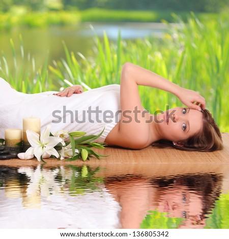 beautiful woman getting treatment in spa salon