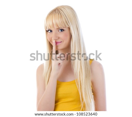 Beautiful woman giving silence gesture against white background