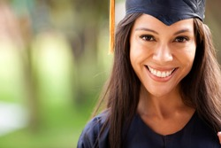 Beautiful woman graduating holding her diploma and smiling