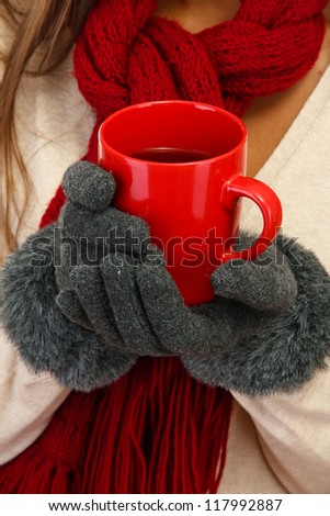 beautiful woman hands with cup of tea, close up