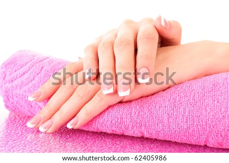 Beautiful woman hands with french manicure on pink background