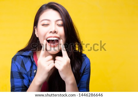 Beautiful woman has beautiful tooth, white teeth, nice tooth alignment. Attractive beautiful young lady take care of teeth very well. She get her teeth cleaned. Pretty girl show her teeth. copy space