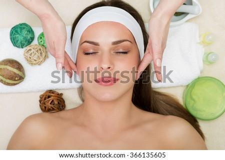 Beautiful woman having a facial massage beauty treatment