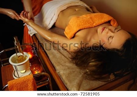 Beautiful woman having a palm massage
