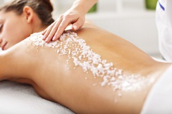 Beautiful woman having exfoliation treatment in spa